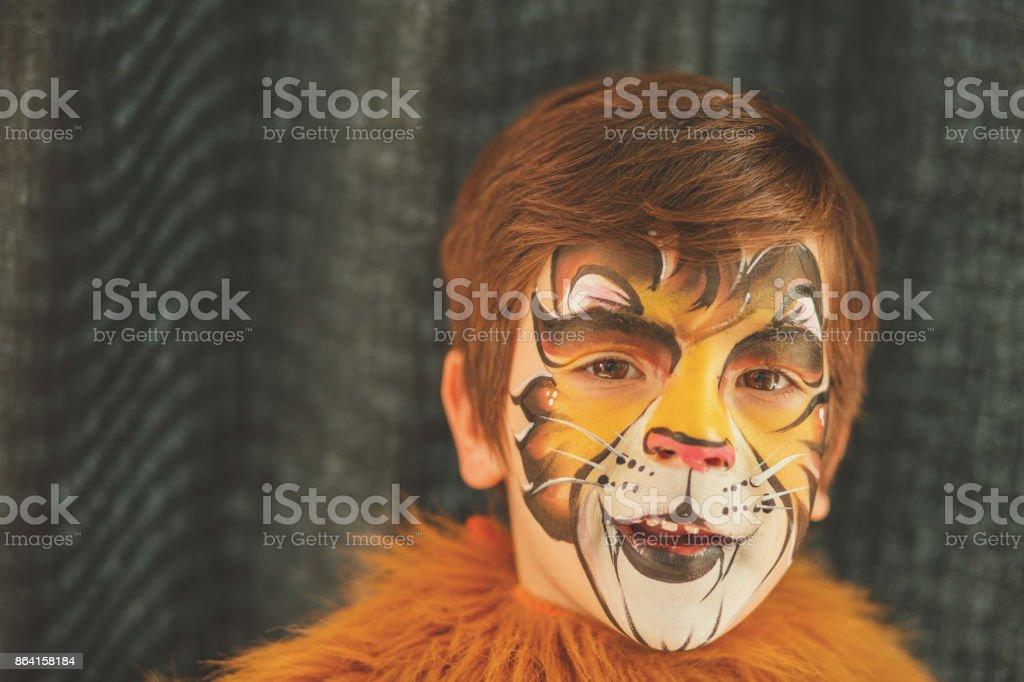 Lion cub face paint royalty-free stock photo