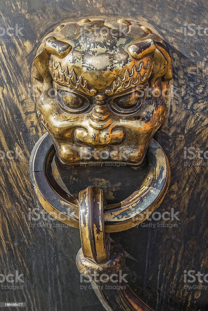 Lion detail on golden pot in the Forbidden City royalty-free stock photo