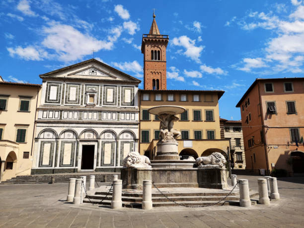 Lion fountain and the Collegiata di Sant' Andrea church, Empoli, Tuscany stock photo