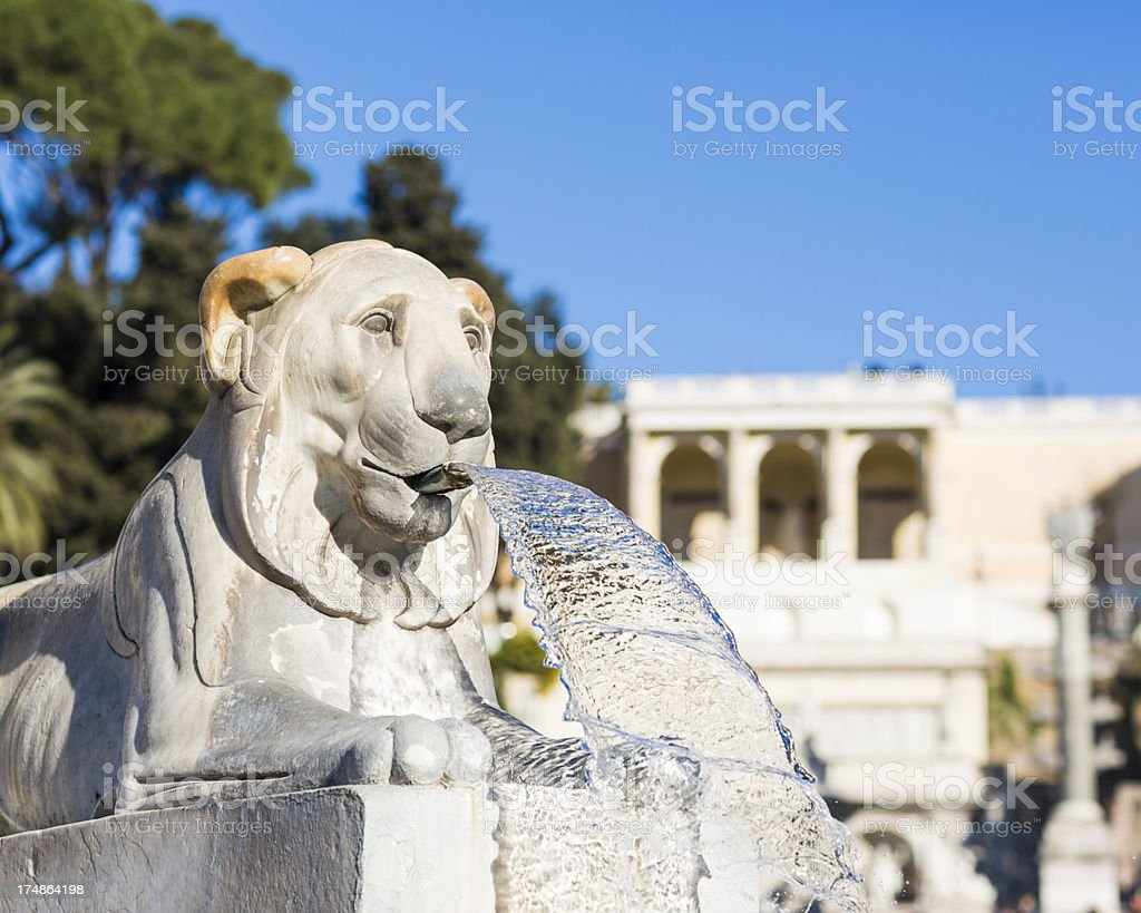Lion fountain at Piazza del Popolo in Rome, Italy royalty-free stock photo