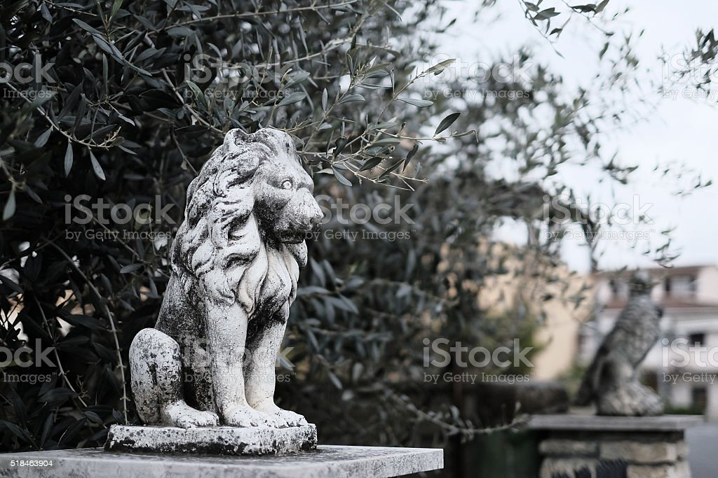 Lion garden statue stock photo