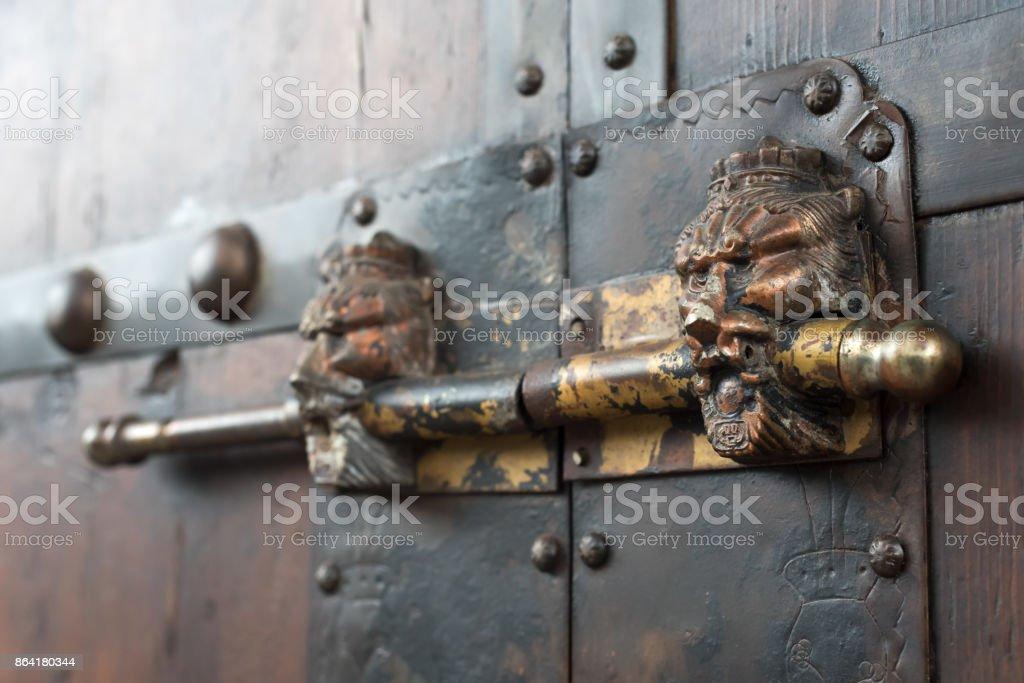 Lion head chinese door locker on a brown wooden door royalty-free stock photo