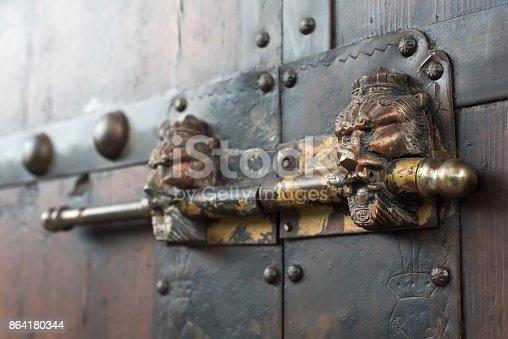 Lion Head Chinese Door Locker On A Brown Wooden Door Stock Photo & More Pictures of Ancient