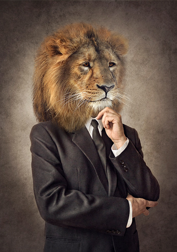 istock Lion in a suit. Man with a head of an lion. Concept graphic. 952496016