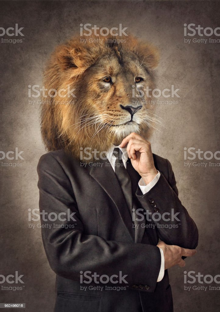 Lion in a suit. Man with a head of an lion. Concept graphic. stock photo
