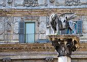 In the Piazza della Erbe, Verona. the Winged lion, symbol of Venice stands atop a marble column