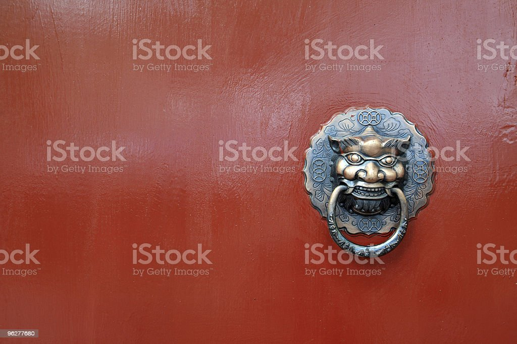 lion on chinese red door royalty-free stock photo