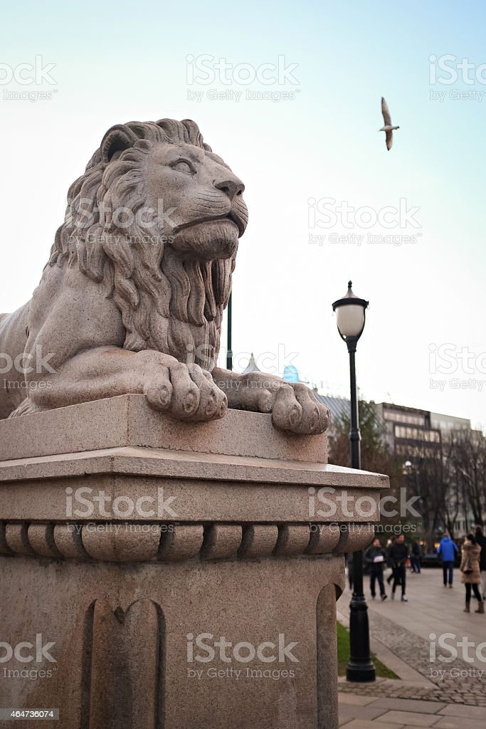 Lion sculpture by Parliament in Oslo stock photo