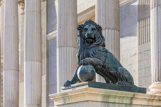 Lion sculpture by the Congress of Deputies - Congreso de Los Diputados Spanish Parliament, Palacio de las Cortes, Madrid stock photo