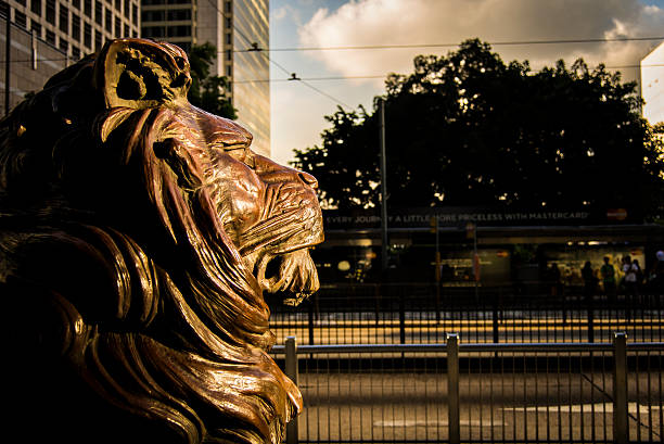 Lion Sculpture of HSBC Central, Hong Kong - July 5, 2013: Symbol of HSBC, the lion sculpture, looking over the other parts of Central in Hong Kong, through good times and bad times. hsbc stock pictures, royalty-free photos & images