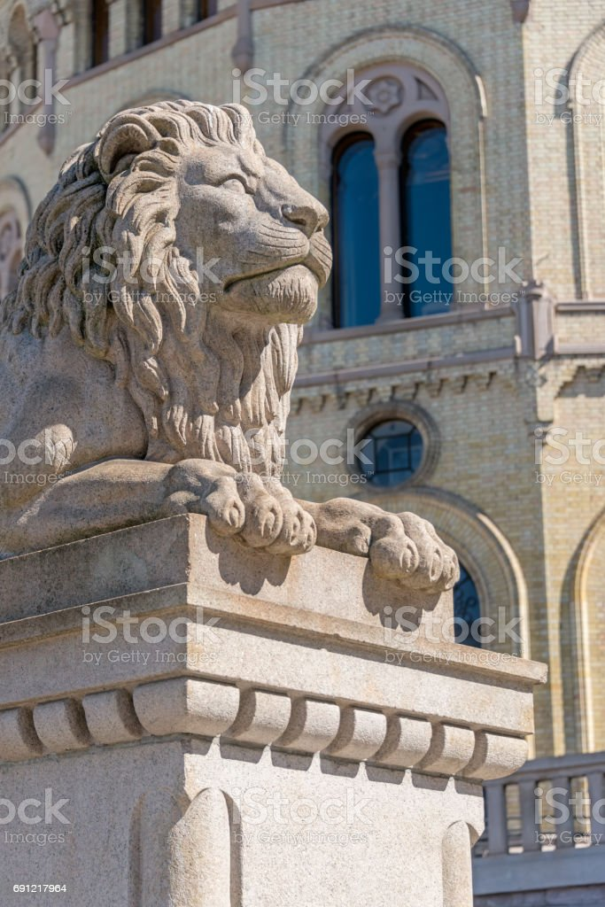 Lion sculpture on front of Parliament of Norway stock photo