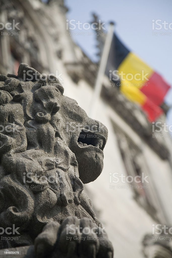 Lion statue and Belgian flag royalty-free stock photo