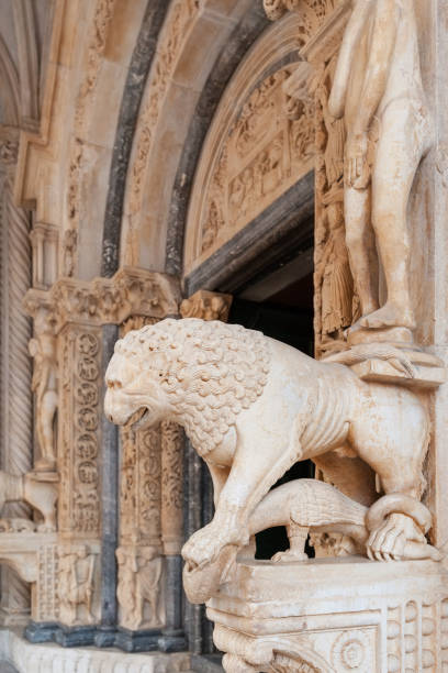 Lion statue at Trogir cathedral entrance stock photo