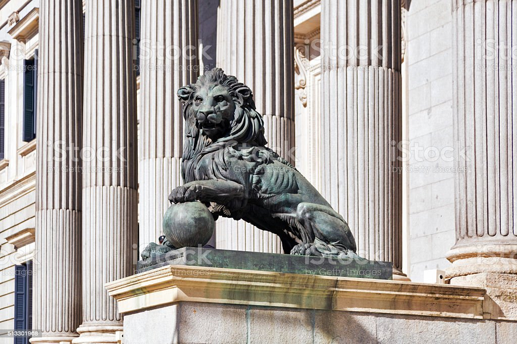 lion statue entrance to Congress of the Deputies stock photo