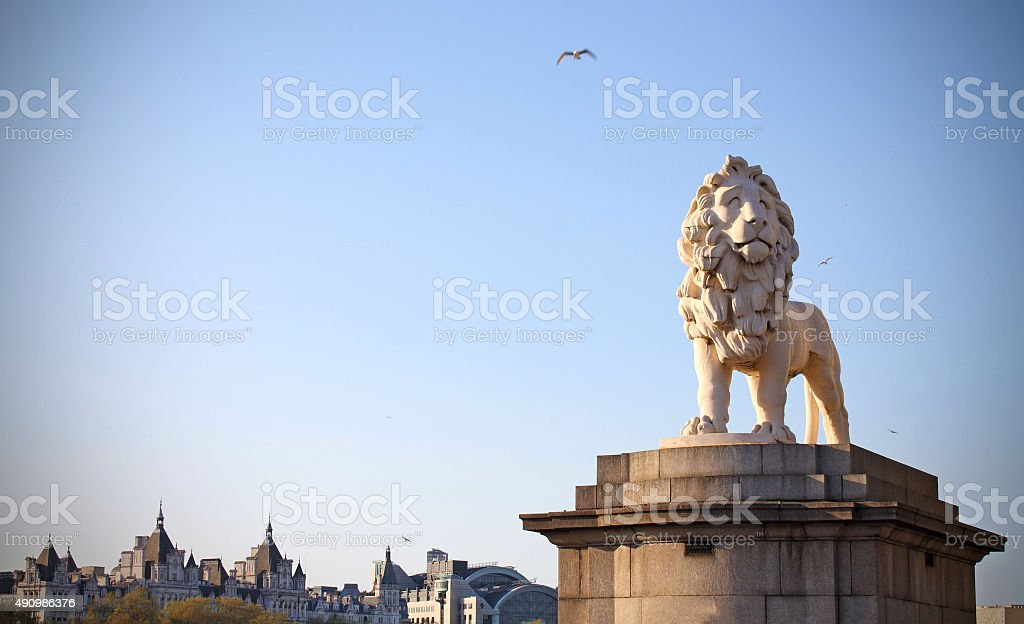 Lion statue guardian of westminster bridge London stock photo