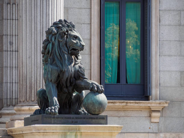 Lion statue in front of Congress of Deputies, Madrid, Spain stock photo
