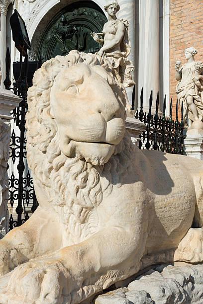 Lion statue in Venice Lion statue in Venice, near the Porta Magna at Venetian Arsenal. porta magna stock pictures, royalty-free photos & images