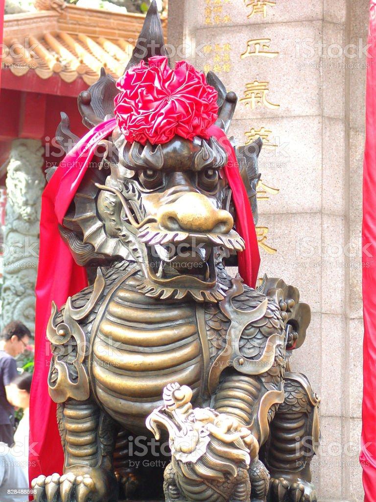 Lion statue outside Wong Tai Sin Temple, Hong Kong stock photo