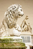 Lion Statue with Palazzo Vecchio in Florence, Italy