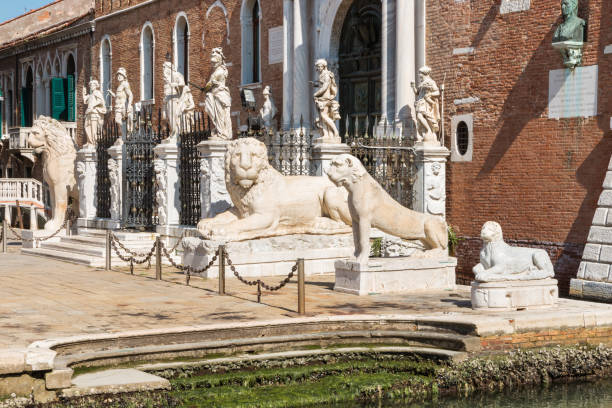 lion statues at the Porta Magna at the Venetian Arsenal lion statues at the Porta Magna at the Venetian Arsenal, Venice, Italy porta magna stock pictures, royalty-free photos & images