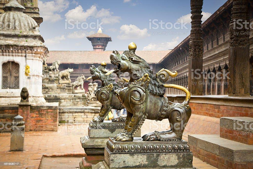 Lion statues on DurbarSquare in Bhaktapur, Kathmandu Valley, Nep stock photo