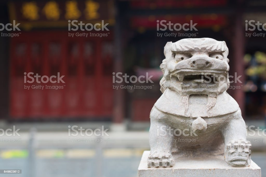 Lion stone statue in a chinese buddhist temple stock photo