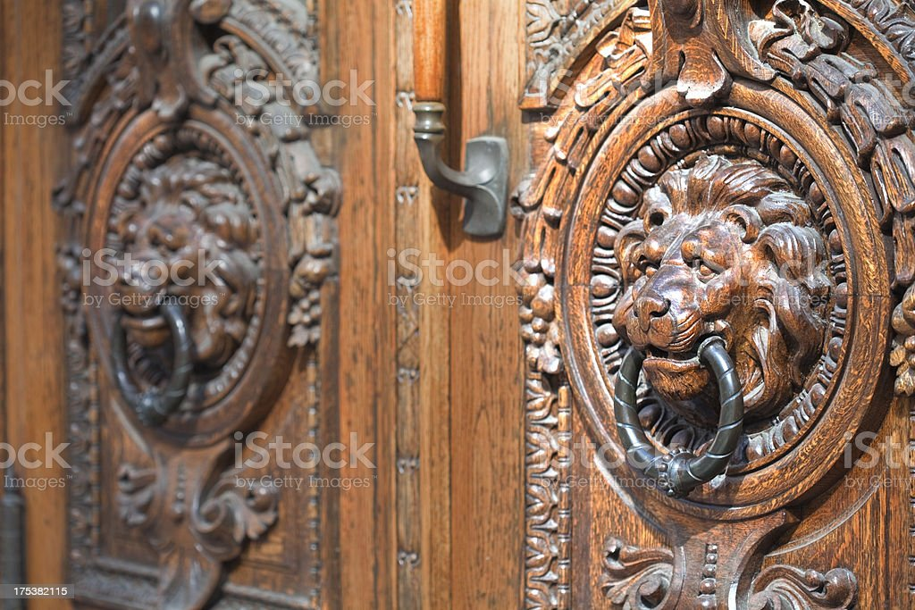 Lions as door knockers royalty-free stock photo