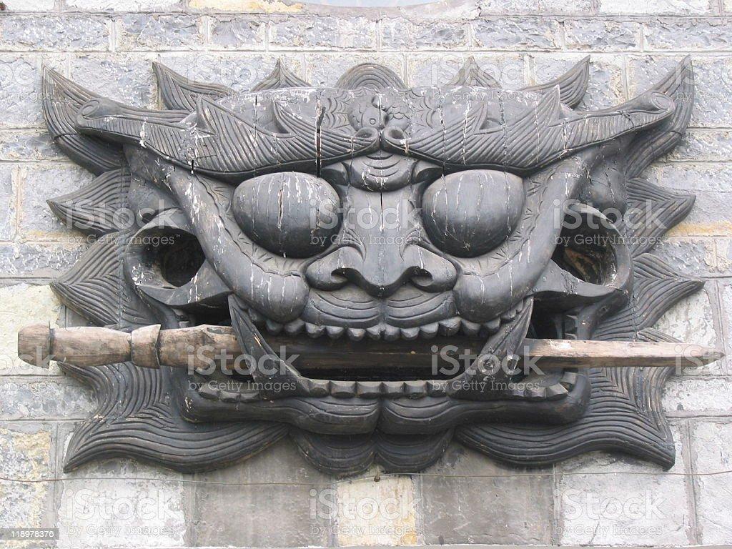 Lion's face sculpture stock photo