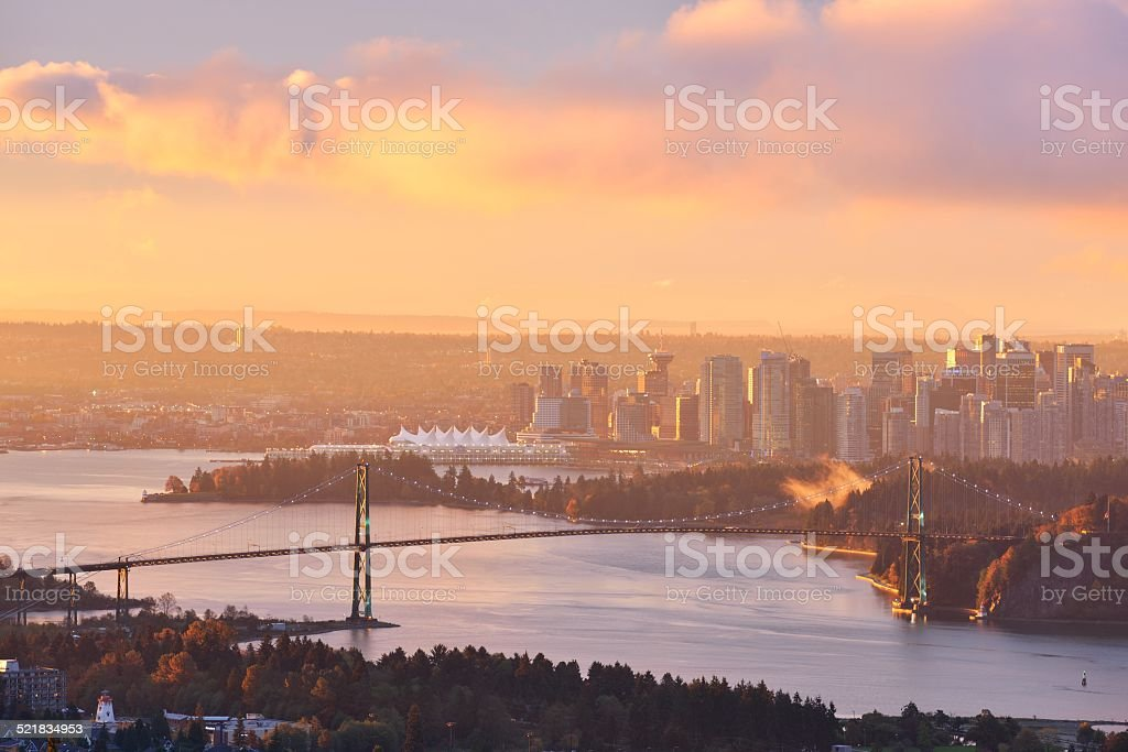 Lions Gate Bridge and Downtown Vancouver at sunrise stock photo