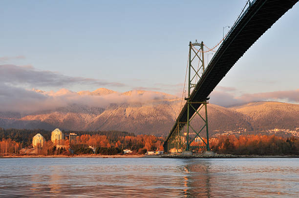 Lions Gate Bridge and Grouse Mountain at sunset stock photo