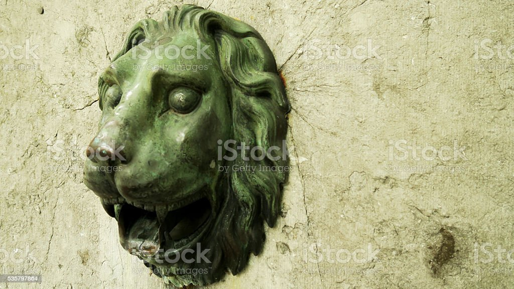 lion's head Copper water pump stock photo