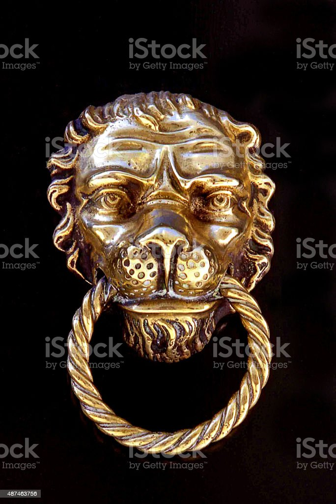 Lion's Head Door Knocker on Black background stock photo