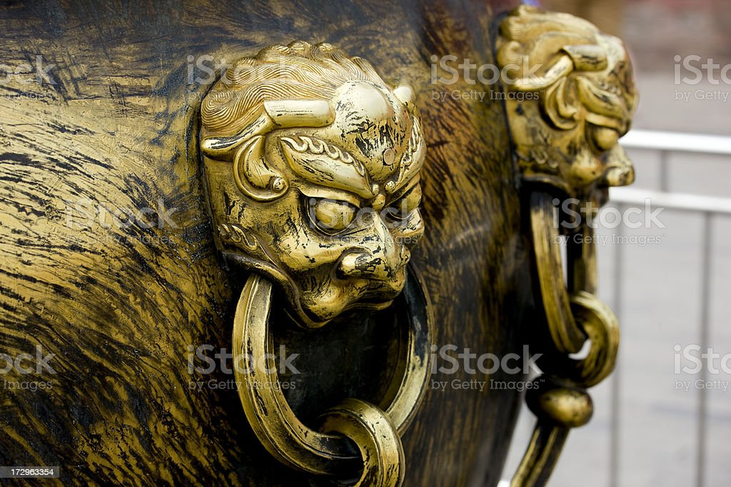 Lions on Vats in Forbidden City royalty-free stock photo