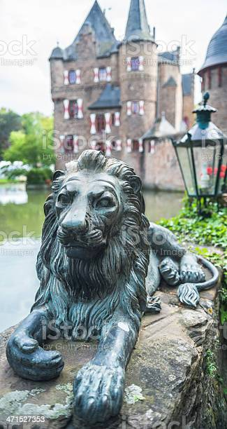 Satzvey, Germany - May 19, 2013: Lion's sculpture as a symbol of protection next to the Satzvey castle