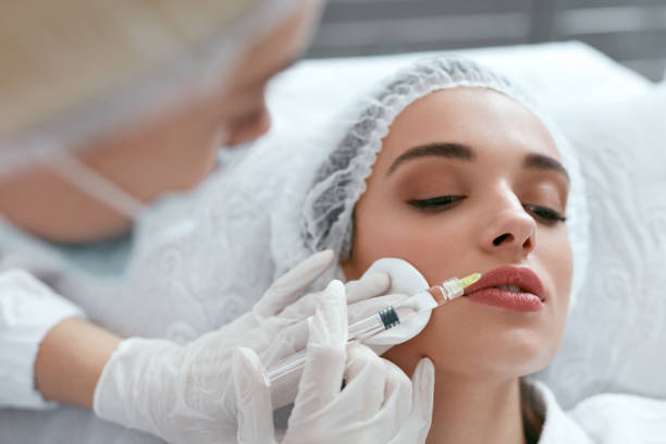 Lip Augmentation. Woman Getting Beauty Injection For Lips Lip Augmentation. Woman Getting Beauty Injection For Lips, Facial Beauty Procedure. High Resolution human lips stock pictures, royalty-free photos & images