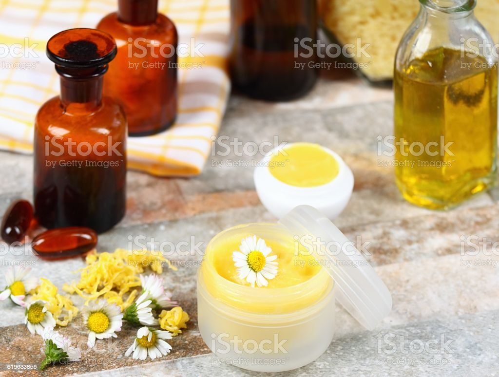 Lip balm  made from olive and coconut oil with beeswax stock photo