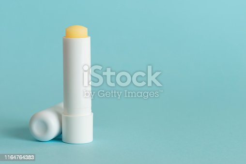 Lip balm packaging mock-up on green background.