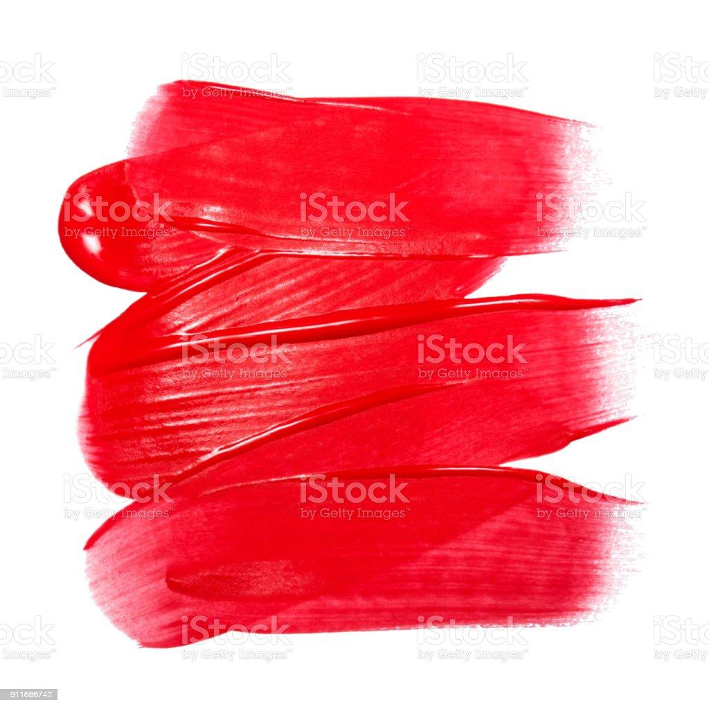 Amostra de brilho labial isolada no branco. Gloss vermelho borrado. Amostra de produto de maquiagem - foto de acervo