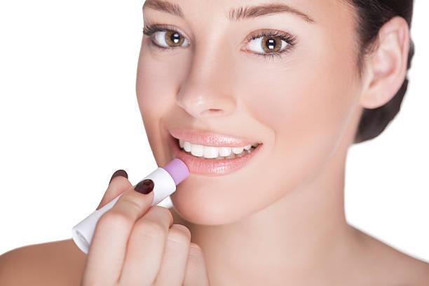 lippen pflege. - labello stock-fotos und bilder
