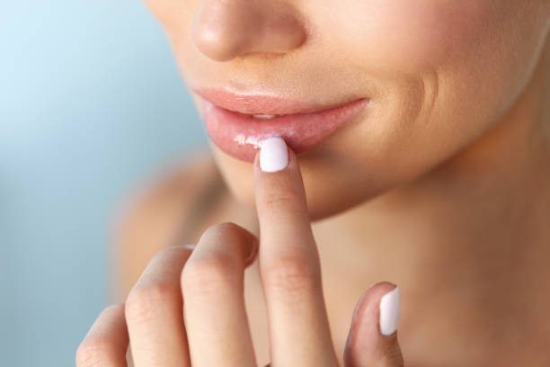 lips protection. closeup of healthy woman lips and smooth skin - human lips stock photos and pictures