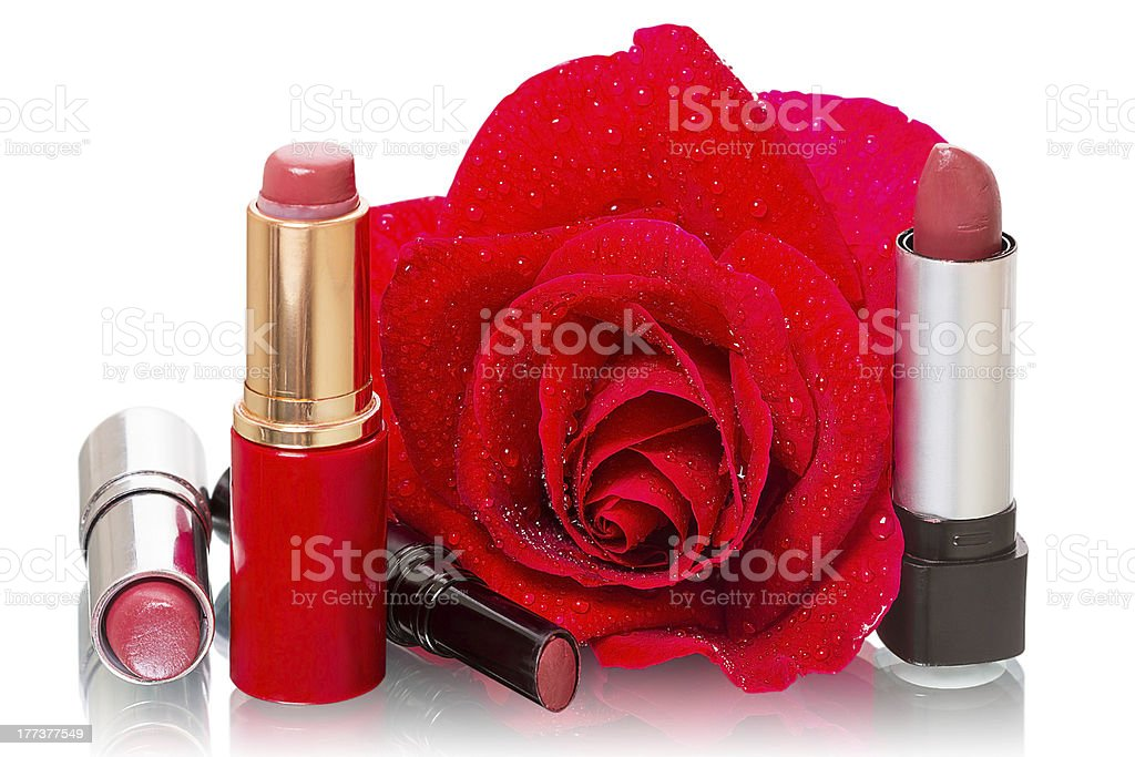Lipstick and a red rose royalty-free stock photo