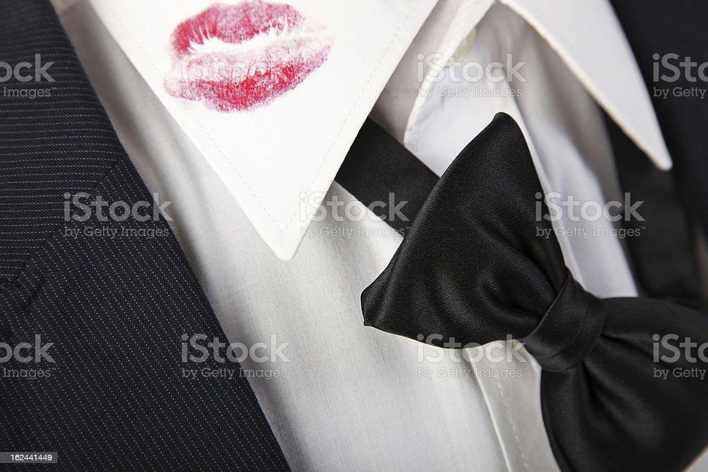 Lipstick kiss on the shirt. stock photo