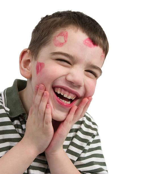 rossetto baci - kids kiss embarrassed foto e immagini stock