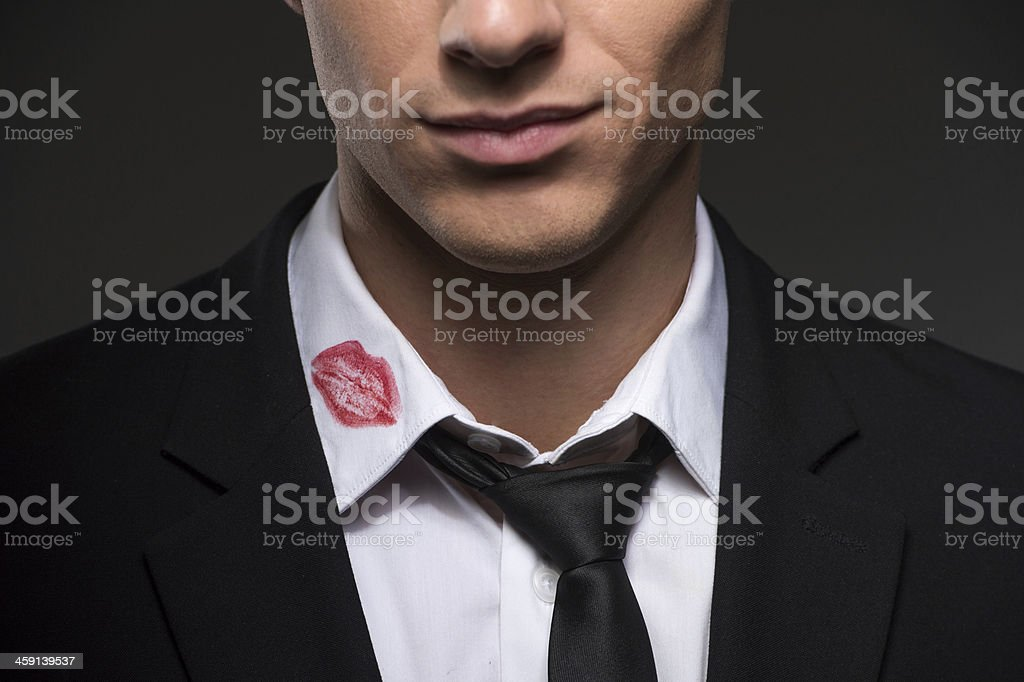 Lipstick on your collar. stock photo