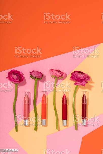 Lipstick pencils with flowers isolated on multi colored background picture id1133376675?b=1&k=6&m=1133376675&s=612x612&h=r3a3fnlq14eay cm hra4sntzzyakhpkqufooruznhc=