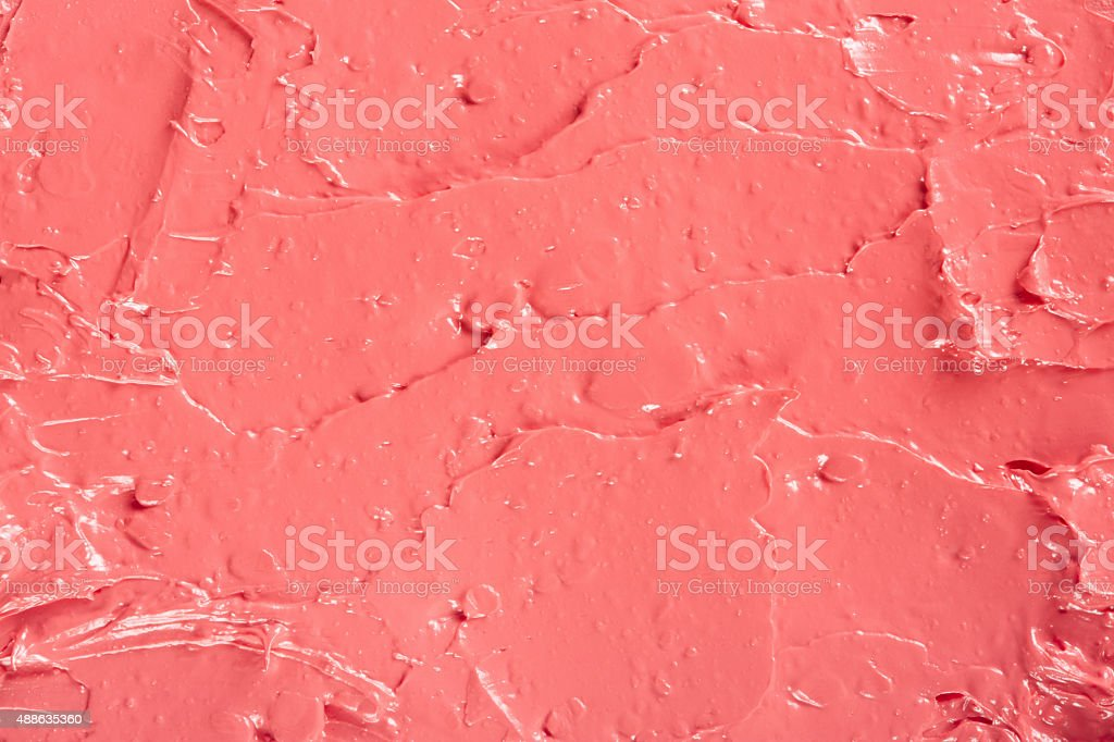 Lipstick red coral color texture background stock photo
