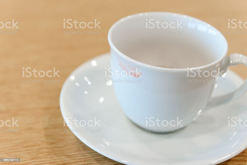 lipstick stain from a woman on ceramic coffee cup - coffee break royalty-free stock photo