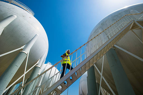 Liquefied Petroleum Gas tanks and Petrochemical Engineer Liquefied Petroleum Gas tanks and Petrochemical Engineer chemical plant stock pictures, royalty-free photos & images