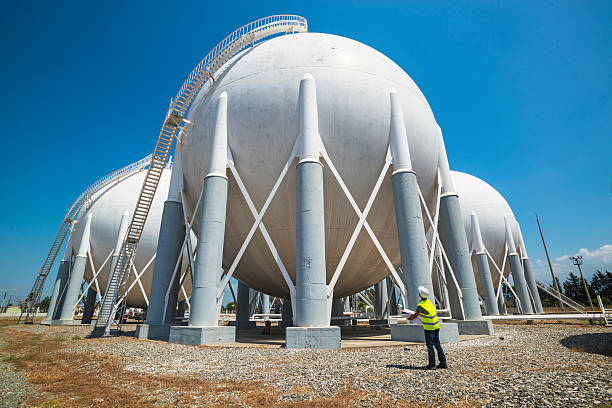 Liquefied Petroleum Gas tanks and Petrochemical Engineer stock photo