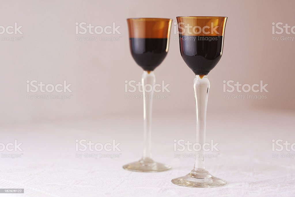 Liqueur in brown glass stock photo